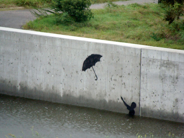 banksy-graffiti-street-art-boy-umbrella