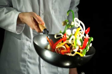 stock-footage-chef-tossing-vegetable-stir-fry-in-wok-in-slow-motion