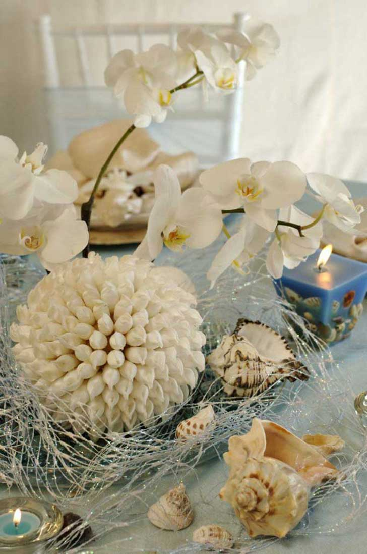 beach-wedding-centerpieces-with-shells-679x1024