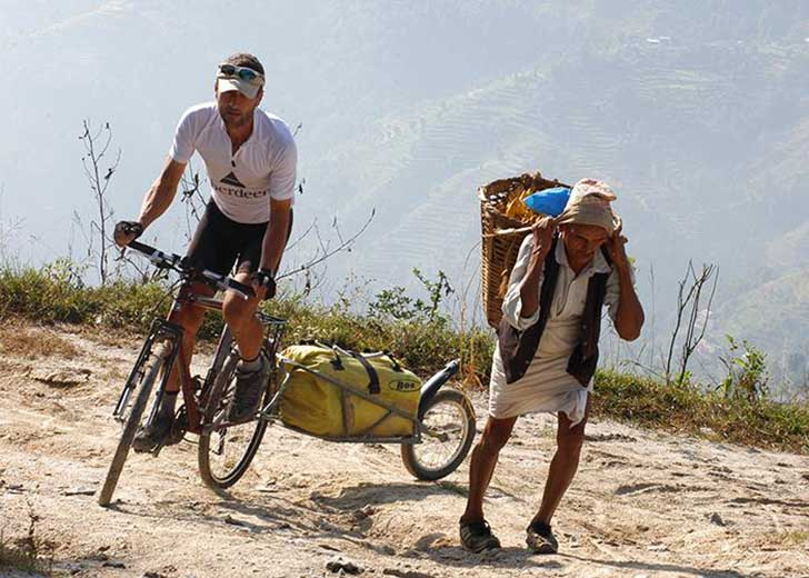 dsc_0292_jason_biking_nepal_man_carry_load-mr_ofrdplw
