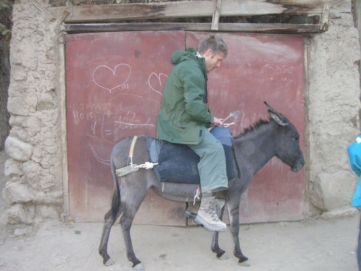 here-he-tries-out-some-local-transportation-in-the-country-a-donkey