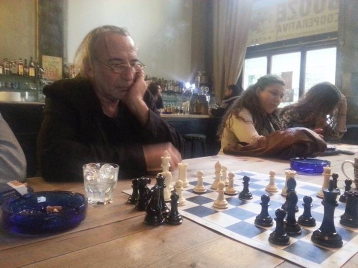 this-picture-shows-a-scene-thats-common-in-greece-men-playing-chess-in-a-coffee-shop